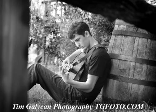 Olathe East Senior pictures portraits outdoor indoor location sessions fence bw black white guitar